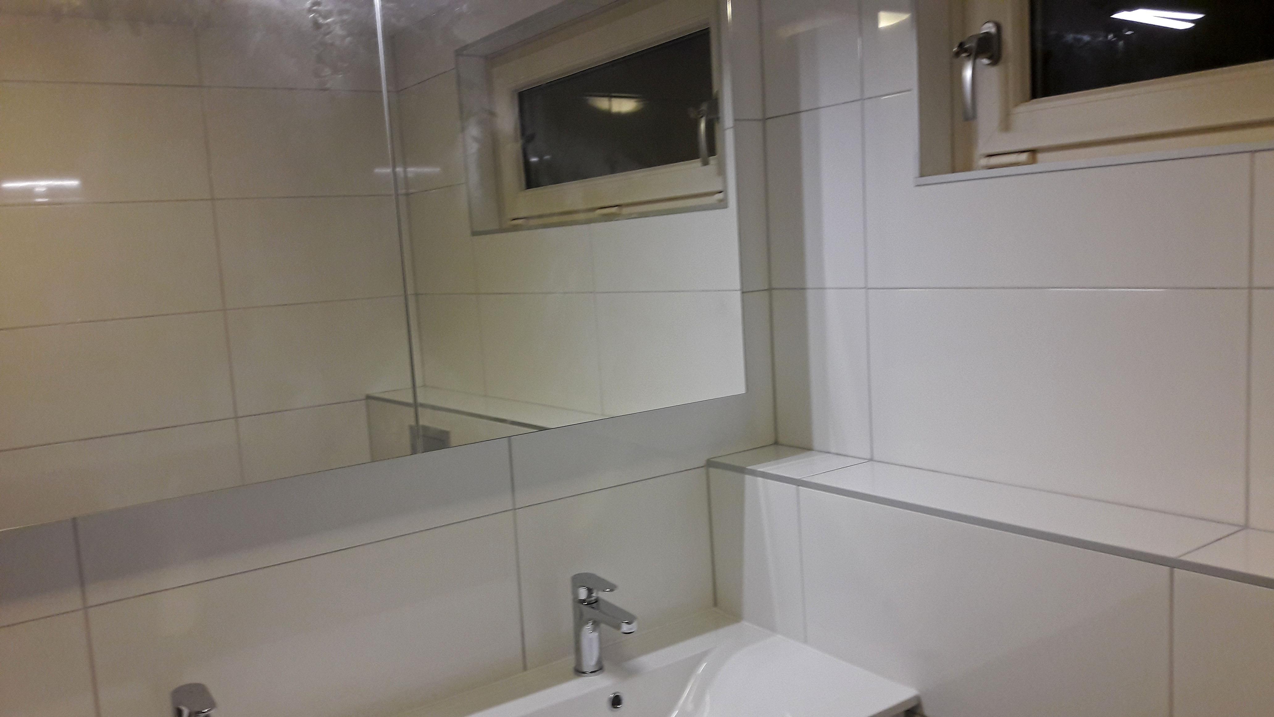 Renovatie badkamer helder wit beterbert klusbedrijf